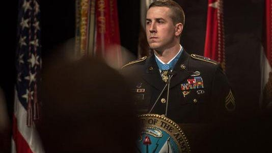 Former Army Staff Sgt. Ryan Pitts, a Medal of Honor recipient, speaks during the Hall of Heroes induction ceremony at the Pentagon on July 23, 2014.