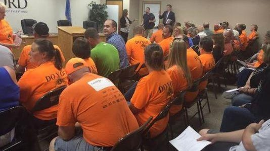 Orange-clad Growing Hartford supporters attended the city council meeting July 7, 2015. It was sparked by controversy over the development director position being closed. Unrest continues in Hartford.