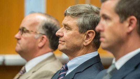 Erv Brinker, center, sits with attorneys Matthew Vicari, left, and Patrick O'Keefe during Brinker's arraignment in East Lansing last week.