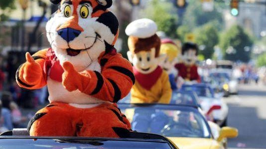 Tony the Tiger and company cruise along during this year's Cereal City Festival Parade.