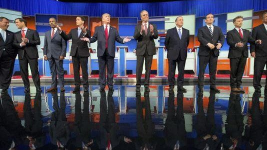 Republican presidential candidates Chris Christie (from left), Marco Rubio, Ben Carson, Scott Walker, Donald Trump, Jeb Bush, Mike Huckabee, Ted Cruz, Rand Paul, and John Kasich take the stage for the first Republican presidential debate at the Quicken Loans Arena Thursday in Cleveland. (AP Photo/Andrew Harnik)