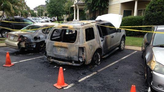 Three vehicles and a door to an apartment were on fire at 5:30 a.m. Monday at Camellia Trace Apartments.
