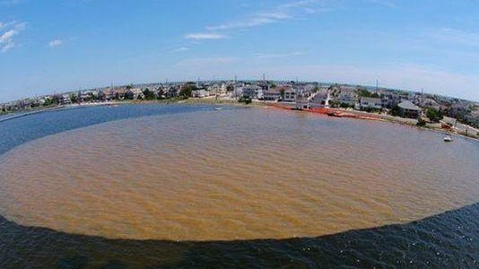The Seaside Park Department of Public Works photographed a brown plume in Barnegat Bay in early August.