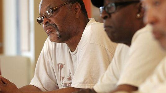 Dwight Williams, 58, of College Hill, left, listens to DeAnna Hoskins, Hamilton County re-entry director, during a mentoring session for people who have served time in prison and are having difficulty finding a good job.