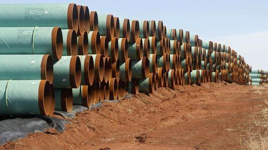 Miles of pipe ready to become part of the Keystone Pipeline wait near Ripley, Okla.