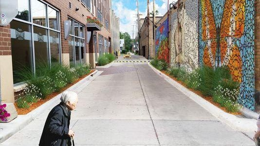 Artist Julian Van Dyke has been selected to paint the mural for Artist Alleys in downtown East Lansing.