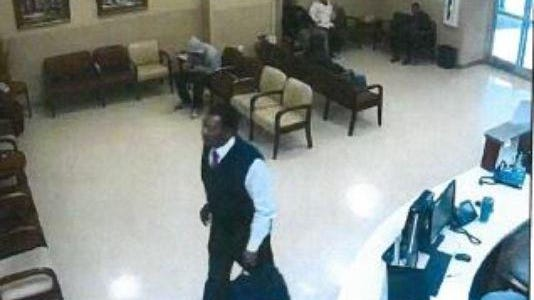 """Jackson police say they are looking for two men who stole $5,000 from a Jackson man Wednesday in a """"pigeon drop"""" scam. One of the men police are looking for is shown in this surveillance image."""