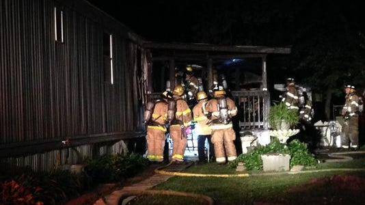The Jackson Fire Department responds to a trailer fire shortly before 10 p.m. Sunday at Parkway Village off Whitehall Street.