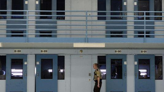 A guard checks on inmates in the Jameson Annex of the South Dakota State Penitentiary.