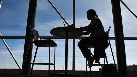 Yany Avelar, a South Dakota State University student at University Center, works on homework in the skyway at UC.