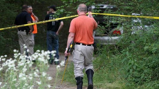 Authorities respond June 2 after a body was found in a burned barn.