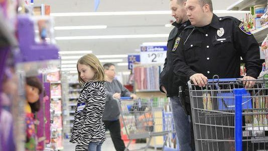 A Daleville Police officer shops with a local family during a past Operation Christmas event.