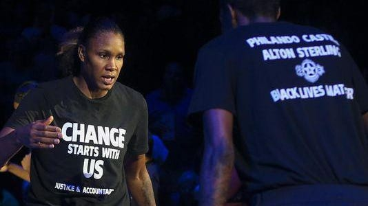 Minnesota Lynx forward Rebekkah Brunson (32) is greeted by Minnesota Lynx forward Natasha Howard (3) while starting lineups are announced at the Target Center on Saturday, July 9, 2016. Lynx players did not wear clothing supporting the Black Lives Matter movement ahead of Tuesday's game in San Antonio after four off-duty police officers walked away from security jobs at a Lynx game over the weekend because of the clothing.