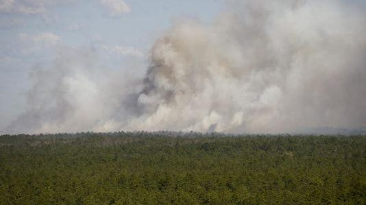 Smoke from a forest fire in the Pinelands is seen from an observation tower in Tabernacle, Burlington County, in 2012.