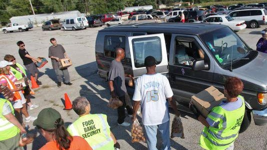 Second Harvest volunteers at a Tailgate event.