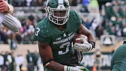 Michigan State's LJ Scott carries for the touchdown that drew the Spartans within one point of Ohio State in the fourth quarter.