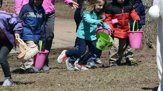 Children in the 4 to 6 age group scramble to pick up plastic eggs during the 2015 Preschool Easter Egg hunt at the Mount Wolf Community Park.