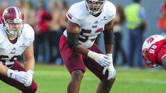 Troy offensive lineman Antonio Garcia was picked by the New England Patriots in the third round of the NFL draft.