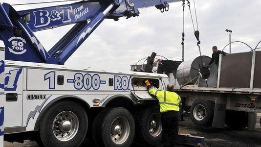 """The suit, filed Monday in Wayne Circuit Court by east-side towing firm Detroit Auto Recovery, claims: """"The city is operating two illegal enterprises: a towing company whose trucks fail to comply with state law; and multiple impound facilities that violate the Zoning Ordinance."""""""