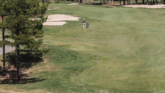 One of the tree-lined holes at the Eagle Ridge Golf Club in Lakewood.