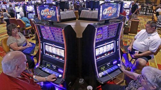 In this July 1, 2013, file photo, casino patrons play some of the 600 slot machines at the Lady Luck Casino Nemacolin, located approximately 70 miles south of Pittsburgh, shortly after its grand opening in Farmington, Pa.