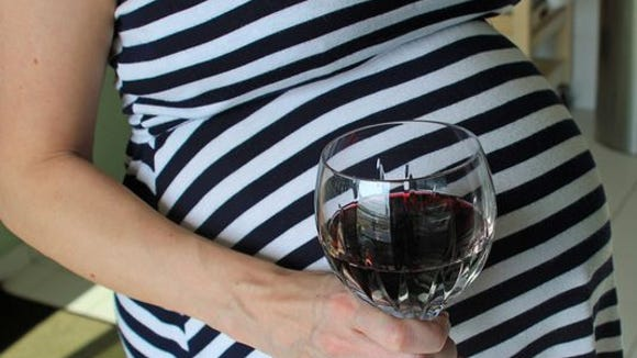 pregnant woman drinking wine getty