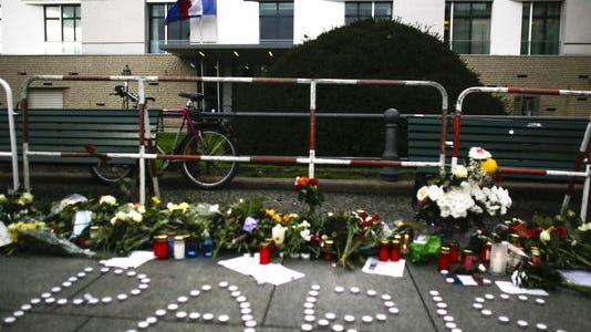 Flowers and candle in front of the French Embassy in Berlin, on Nov. 14, 2015.