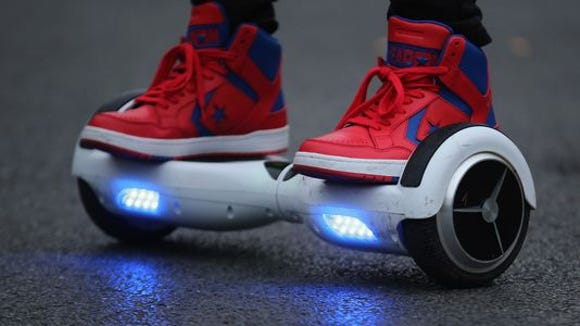 A youth poses as he rides a hoverboard, which are also known as self-balancing scooters and balance boards, on October 13, 2015 in Knutsford, England. (Photo: Getty Images)
