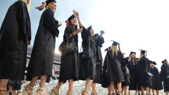 You graduated college, and now it feels like you'll be paying for it indefinitely. In 2016, put even $5 to $10 more a month toward student loan debt. It can make a difference in how fast you pay off you loans. (Photo: AP)