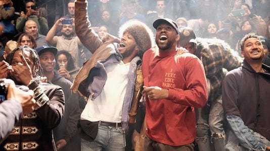"Kid Cudi, left, and Kanye West during the ""Yeezy Season 3"" album launch and fashion show at Madison Square Garden in New York Thursday."
