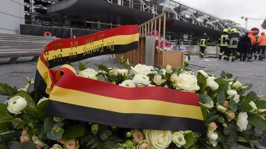 A wreath is placed in front of the damaged Zaventem Airport terminal in Brussels on Wednesday, March 23, 2016.