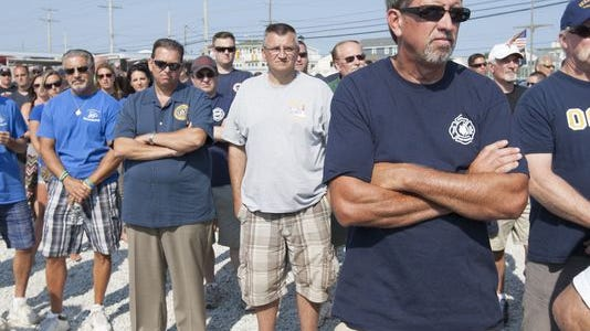 Around 300 firefighters, police and other public employees attended a town-hall meeting on Long Beach Island in July 2014 to protest the way Gov. Chris Christie has handled their pensions.