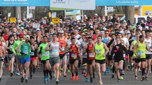 Oceanport, NJ 11,000 runners compete in the 19th New Jersey Marathon that started at Monmouth Park and finished on the promenade in Long Branch.