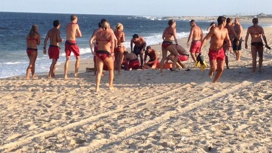 Sandy Hook lifeguards attempt to revive Sarmad Rizvi, who was pulled into the water by a rip current.