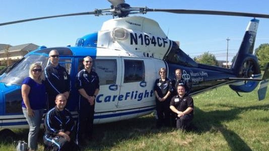 Mason City Council rejected a request from the new Atrium Health Center Mason to construct a new hospital helipad at 7450 Mason-Montgomery Road after local residents and business owners protested the move. The helicopter, seen here at the hospital's groundbreaking ceremony on Aug. 28, 2014, was expected to transport two to five critical patients a year from the facility.