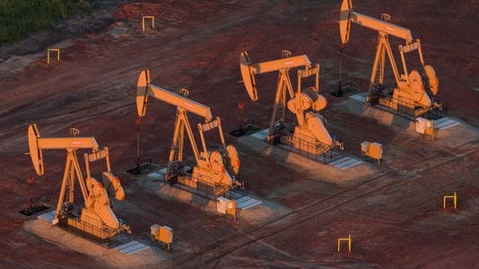 Pumpjacks are seen in an aerial view in the early morning hours of July 30, 2013, near Watford City, N.D.