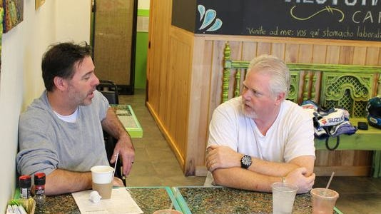 Chefs Neil Griffin, left, and Todd Johnson talked Southwest Florida Wine & Food Fest during a recent lunch at Restoratives Cafe in Estero.
