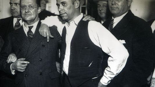In this photo, famed bank robber John Dillinger poses with the Lake County prosecutor in the jail in Crown Point. Dillinger escaped from the Crown Point Jail in 1934, leading the FBI and the police on an interstate chase, before finally being shot and killed outside a theater in Chicago. The Dillinger museum at the Lake County Visitors Center along I-94 will be closing next week in preparation for a move to downtown Crown Point.