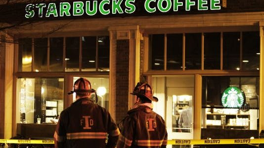 Firefighters cordoned off a portion of sidewalk in front of the Starbucks Coffee shop at 430 Massachusetts Ave. in Downtown Indianapolis on Monday, March 16, 2015, after an underground transformer malfunctinoed.
