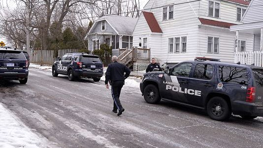 Charges have been filed against four men accused in an altercation Monday that left three Lansing police officers injured.