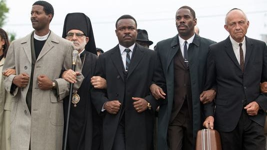 "David Oyelowo, center, as Dr. Martin Luther King, Jr. in ""Selma."""