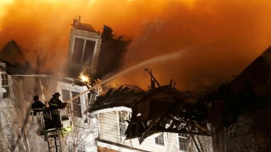 Workers doing maintenance at an apartment complex across the Hudson River from New York City accidentally started a fire that caused massive damage and displaced more than 1,000 people, officials said Thursday.