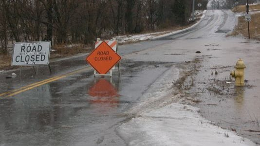 Flooding shut down Drakes Creek Road just north of Stop Thirty Road in Hendersonville.