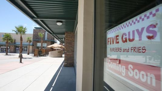 The 'coming soon' sign, posted last summer. At lunchtime, the shopping center is usually packed with hungry customers going to nearby Rubio's, Panera Bread or Dickey's Barbecue Pit.