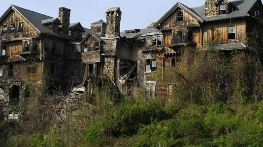 Halcyon Hall, the main building on the former Bennett College campus in Millbrook, is in a dilapidated state after years of abandonment. It will come down, its new owners say. Part of the land will become a park.