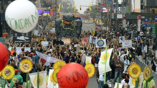 Participants rally at a People's Climate Change March in New York City in 2014.