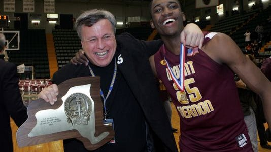 Mount Vernon basketball coach Bob Cimino, left, with Jamell Walker celebrating the team's victory in the 2011 Class AA finals. Walker, who went on to play at Westchester Community College and transferred to Florida A&M University, where his scholarship was rescinded due to transcript fraud.