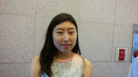Christine Ji Woo Kang