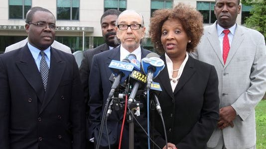 Marie Elias, a Westchester resident and sister of Herve Gilles, spoke at the Rockland County Courthouse in April 2012 after a grand jury found Spring Valley Police Officer John Roper shot her brother, Herve Gilles, in self defense. Standing to her immediate right was attorney Sanford Rubenstein