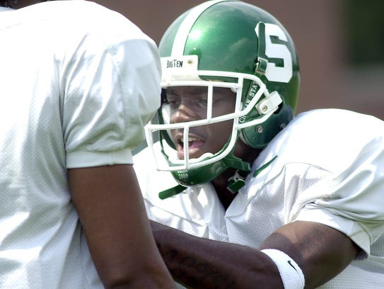 Charles Rogers, MSU wide receiver, runs through some